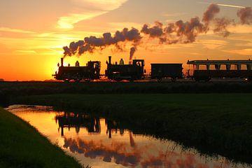 Tramway à vapeur avec soleil couchant sur Richard Krol