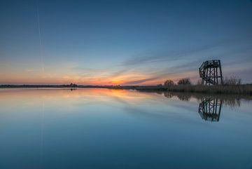 Uitkijktoren bij zonsondergang van Marcel Kerdijk