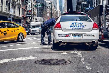 New York Politie auto en gele taxi