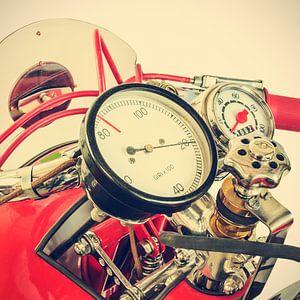 Detail of a classic Ducati Cucciolo motorcycle