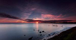 Visnetten in de Waddenzee bij zonsopkomst