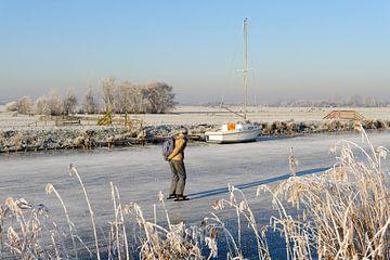 Winterlandschap met schaatser von Merijn van der Vliet
