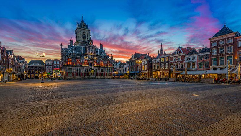 Delft bij zonsondergang ... van Marcos Dijkos