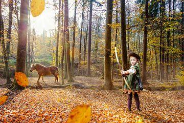 Junge spielt Robin Hood im Herbstwald von Jürgen Neugebauer | createyour.photo