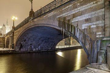 Tijdens sneeuwval aan het Sint Baafsbrug zien naast de Leie van Gent van Marcel Derweduwen