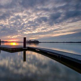 A jetty at sunset von Koos de Wit