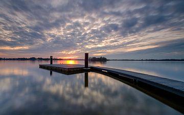 A jetty at sunset sur Koos de Wit