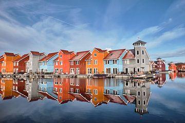 Kleurrijke houten pierwoningen van Jef Folkerts