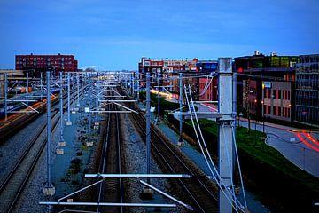 Spoorlijn bij Houten Zuid, gefotografeerd vanaf de fietsbrug. van Margreet van Beusichem