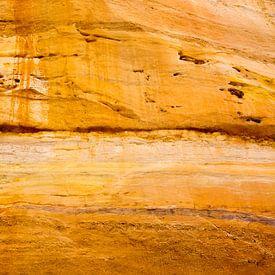 Zonnig kleurenspel op de rotsen. van Jack Drenthe